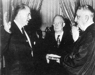 Ezra Taft Benson and Dwight D. Eisenhower as Benson is sworn in
