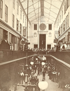 """[I]t appeared to reach to the very heavens.  It was full of doors and windows, and they were all filled with people, who were very finely dressed."" (Lucy Mack Smith 1853, 59, describing a dream of Joseph Smith Sr.)  1877 photograph of the Reynolds Arcade interior (built 1828), looking south toward the front entrance.  From the Collection of the Rochester Public Library Local History Division; used with permission in Mormon Parallels, p. 1401."